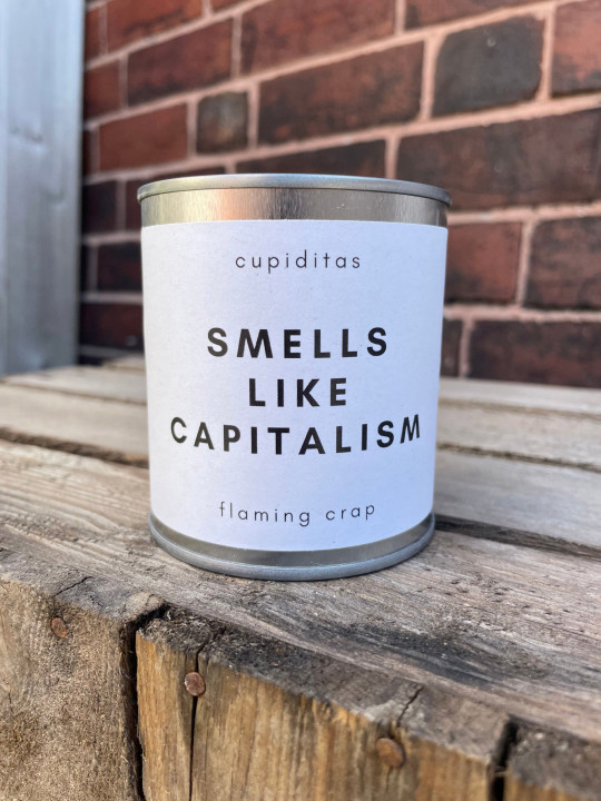the smells like capitalism candle from flaming crap