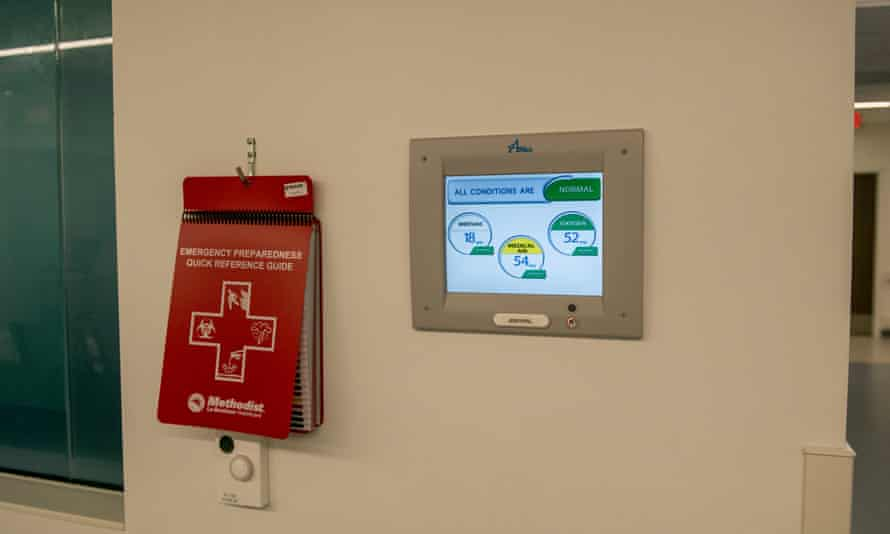 An information screen shows conditions are normal inside the Covid isolation unit at Methodist University hospital.