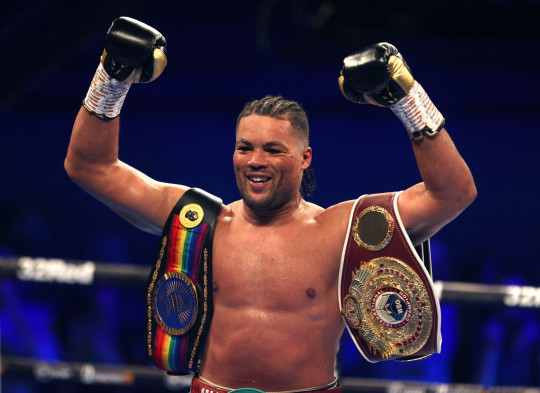 Joe Joyce celebrates victory against Carlos Takam after the WBO International, WBC Silver and Commonwealth Heavyweight Title Championships at the SSE Arena, London. Picture date: Saturday July 24, 2021. PA Photo. See PA story BOXING London. Photo credit should read: Steven Paston/PA Wire. RESTRICTIONS: Use subject to restrictions. Editorial use only, no commercial use without prior consent from rights holder.