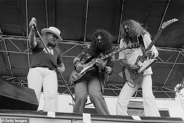Founding member: Rossington (center) helped form the original incarnation of Lynyrd Skynyrd, called My Backyard, in 1964; he is seen with Ronnie Van Zant and Allen Collin in 1977, four months before the deadly plane crash that would derail the band for a decade
