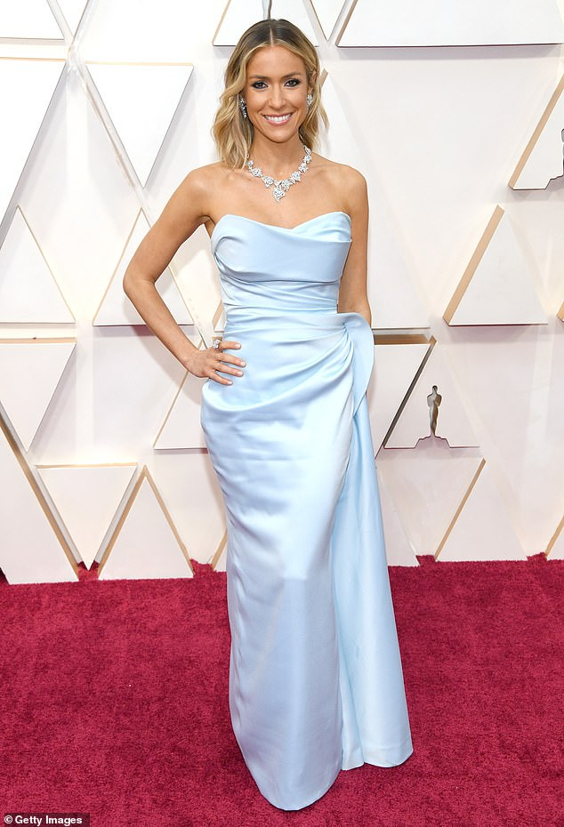 High hopes: The reality television personality also wrote that she wanted her daughter to 'wear the same outfit when even she's 16'; she is seen at the92nd Annual Academy Awards in 2020