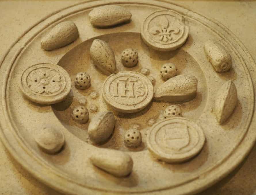 Another carving depicts biscuits and almonds
