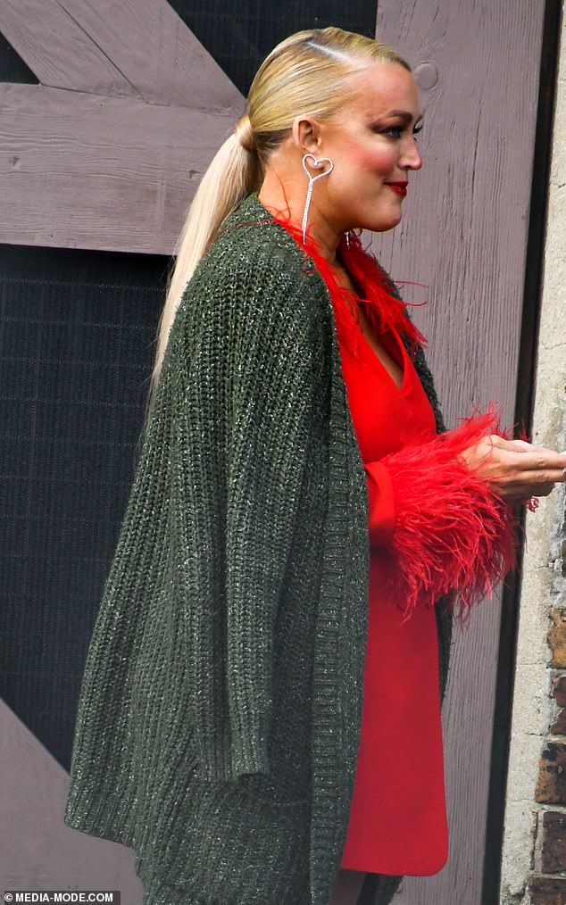 Bold:The 46-year-old looked striking in a bright red blazer dress and a bold makeup palette