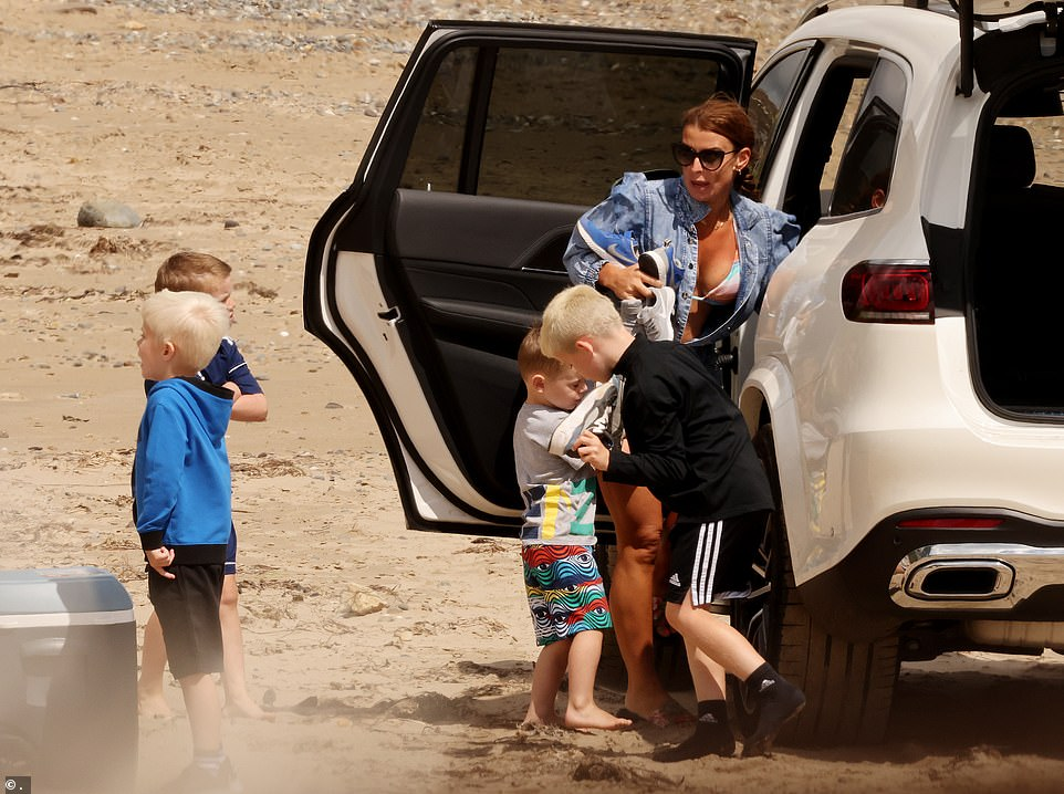 Her boys: She was joined on the beach bysons Kai, 11, Klay, eight, Kit, five, and Cass, three