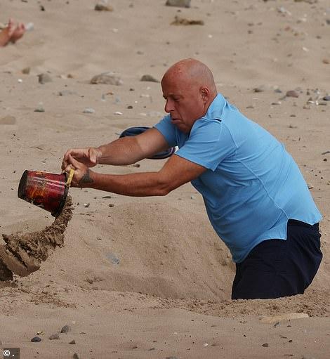 Woah! Coleen's dad Tony was helping build sandcastles