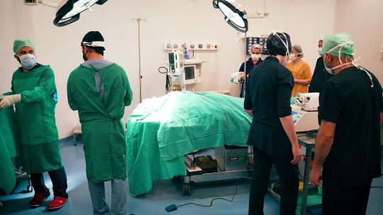 Surgeons surround Katie Price in hospital during her operation