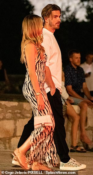 Stunning: Sasha looked sensational in her black and white animal print frock