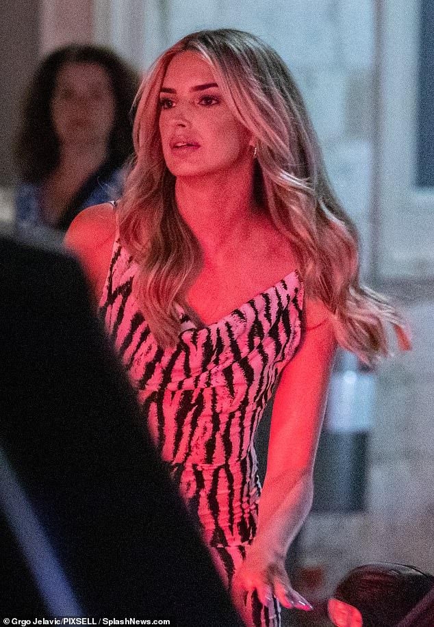 Beauty: Sasha's long blonde tresses were styled into glamorous waves
