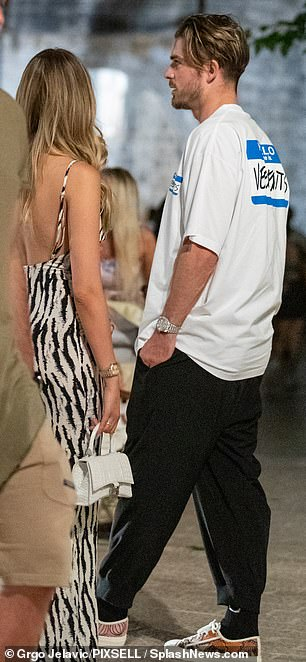 Easy breezy: The footballer woreblack jogging bottoms and an oversized white T-shirt with statement trainers