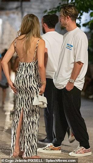 Sensational: Sasha's elegant dress perfectly showcased her model physique