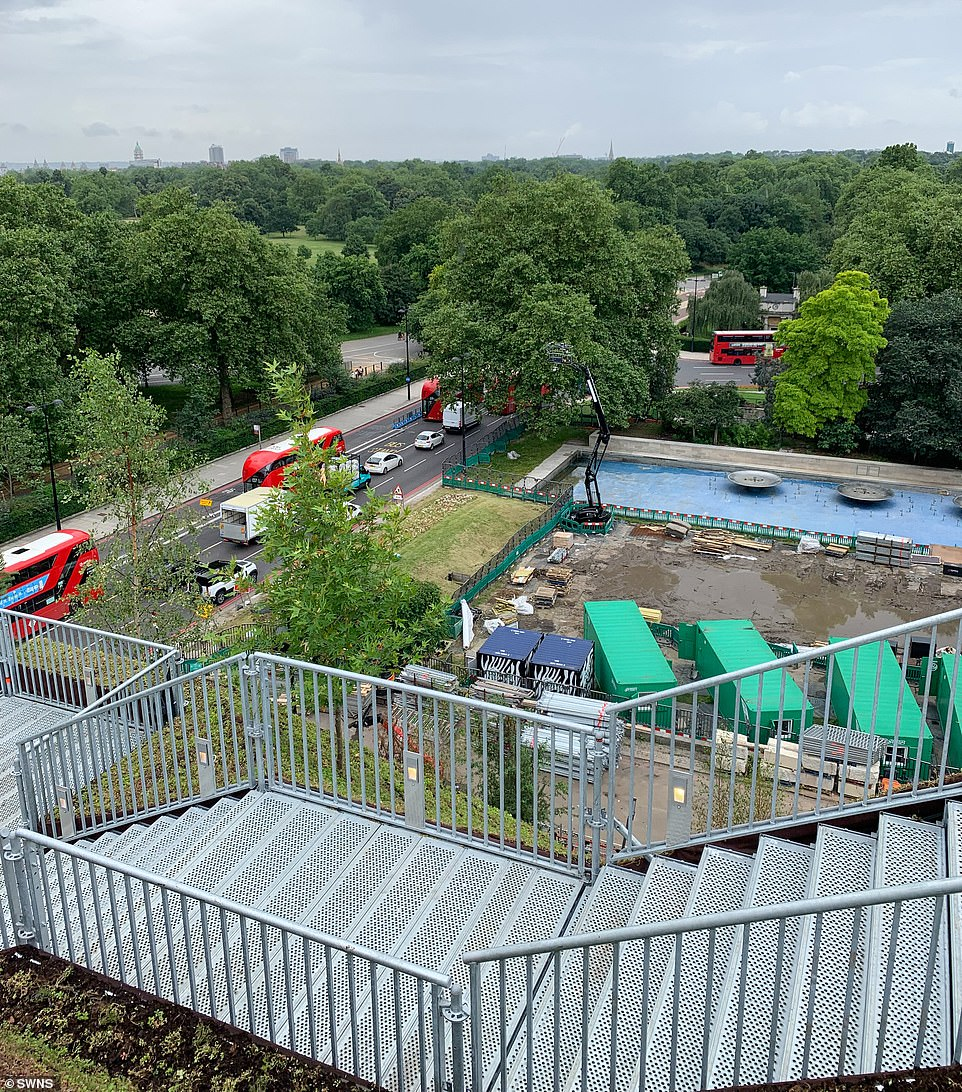 One of the less than impressive views from the mound, showing a metal staircase, metal containers and road traffic