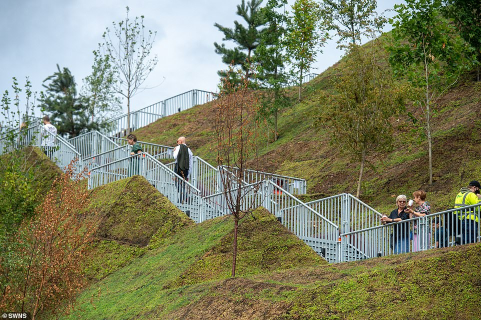 Visitors reach the top of the mound via a long metal walkway. The turf on the mound is only in the early stages of growth