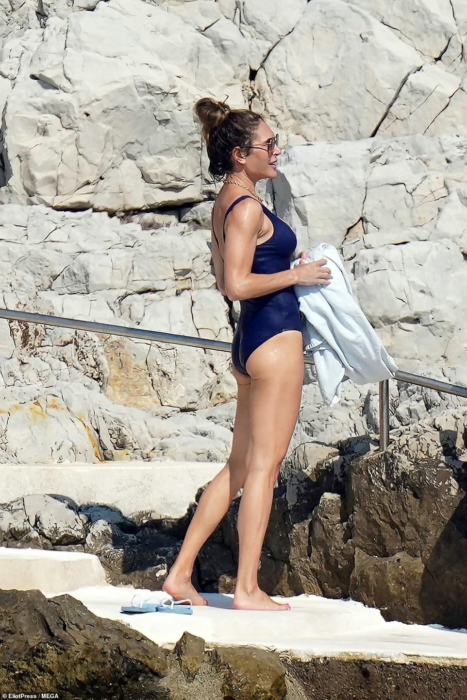 Gorgeous: Ayda's lithe figure was unmissable as she dried off and called back to her friends to chat from the water's edge