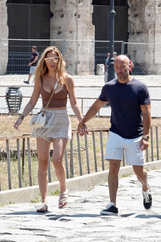 Chrishell Stause and Jason Oppenheim are spotted walking hand in hand while visiting the Colosseum and the Roman Forum before packing up and leaving Rome.Chrishell Stause and Jason Oppenheim are spotted walking hand in hand while visiting the Colosseum and the Roman Forum before packing up and leaving Rome. 30 Jul 2021 Pictured: Chrishell Stause; jason Oppenheim. Photo credit: professor sorcio / MEGA TheMegaAgency.com +1 888 505 6342