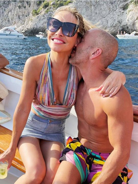 Jason Oppenheim kissing Chrishell Stause