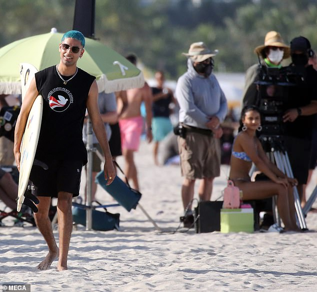 Surfer boy: The Ms. Marvel actor was seen walking off with a surfboard in hand