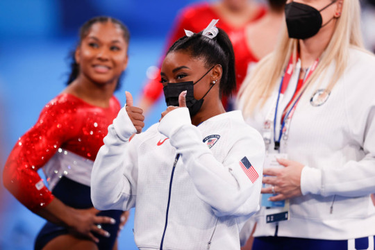 Simone Biles is still scheduled to compete in the uneven bars final on Monday