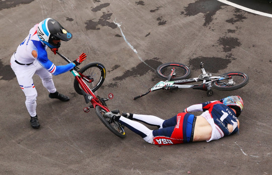 TOKYO, JAPAN - JULY 30: Romain Mahieu of Team France checks on Connor Fields of Team United States after a crash on day seven of the Tokyo 2020 Olympic Games at Ariake Urban Sports Park on July 30, 2021 in Tokyo, Japan. (Photo by Francois Nel/Getty Images)