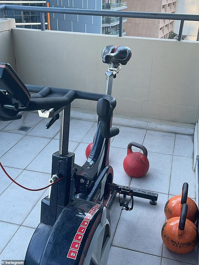 Keeping fit: The NRL player will often workout on his hotel balcony, where he has set up a range of gym equipment including an exercise bike and kettle bells