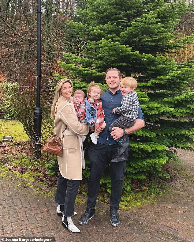 Reunited: Burgess mentions the thing he is most excited about once he leaves quarantine is seeing his family. Pictured with his wife and children