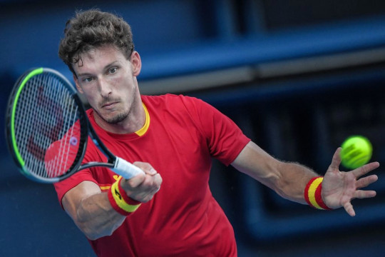 Spain's Pablo Carreno Busta returns a shot to Serbia's Novak Djokovic during their Tokyo 2020 Olympic Games men's singles tennis match for the bronze medal at the Ariake Tennis Park in Tokyo on July 31, 2021.
