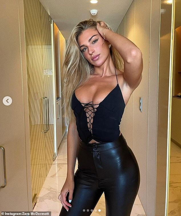 Leather look: She flaunted her surgically enhanced cleavage in a plunging black corset top, which featured a daring cut-out section across the bust, adorned with lace