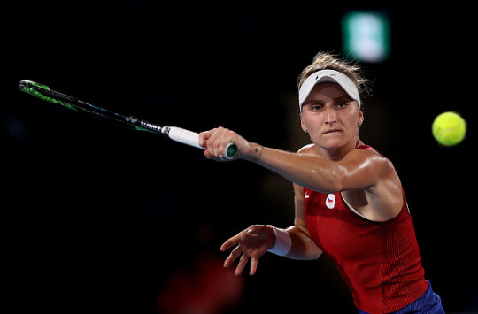 Marketa Vondrousova of Team Czech Republic plays a backhand during her Women's Singles Gold Medal match against Belinda Bencic of Team Switzerland on day eight of the Tokyo 2020 Olympic Games at Ariake Tennis Park on July 31, 2021 in Tokyo, Japan.
