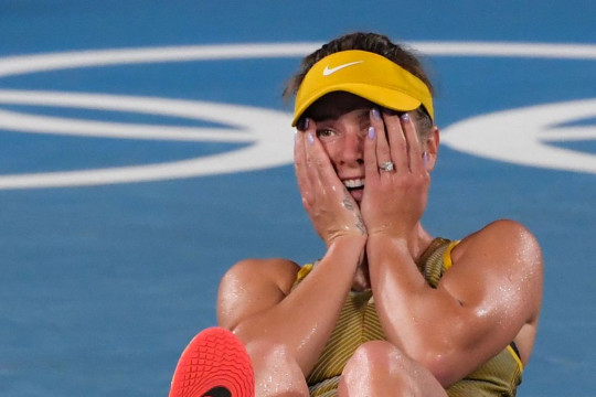 Ukraine's Elina Svitolina reacts after she defeated Kazakhstan's Elena Rybakina during their Tokyo 2020 Olympic Games women's singles tennis match for the bronze medal at the Ariake Tennis Park in Tokyo on July 31, 2021.