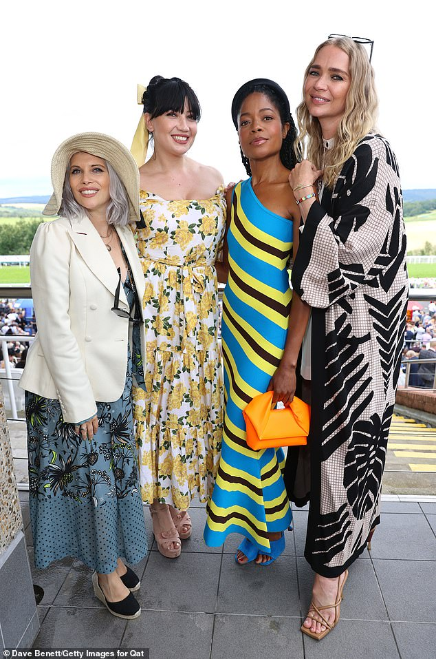 Strike a pose:The model, 42, appeared in good spirits as she posed alongside a glamorous Daisy Lowe and Naomie Harris as the ladies enjoyed a day at the races in Chichester
