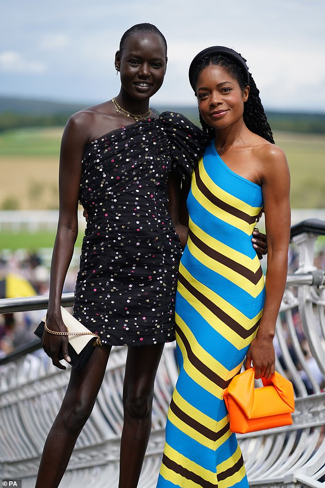 Gorgeous:The No Time To Die star commanded attention in her bold ensemble as she posed with model Ajak Deng at the racecourse in Cheshire