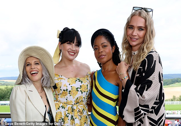 Lovely:She flashed a dazzling smile as she posed with the ladies, with the trio also posing alongside presenter Pips Taylor