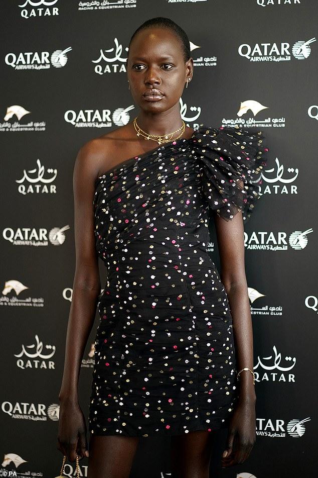 Sensational: Australian model Ajak, 31, put on a leggy display in a revealing black spotted dress, teamed with metallic gold heels