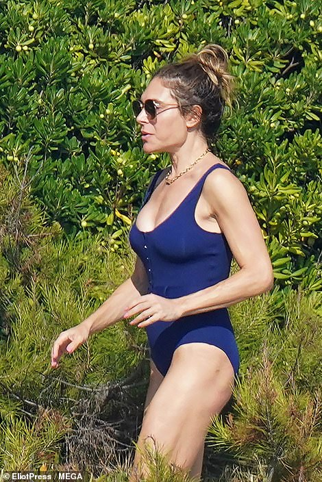 Wow: Ayda Fields looked incredible as she stepped out in the South of France and flaunted her figure in a low cut navy swimsuit on Friday