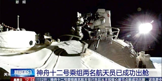 Two astronauts on Sunday made the first spacewalk outside China's new orbital station to set up cameras and other equipment using a 15-meter-long (50-foot-long) robotic arm. (AP)