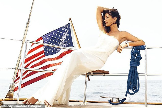 Special occasion: Cindy was seen wearing a flowing white dress while posing in front of an American flag in a 4th of July-themed snap