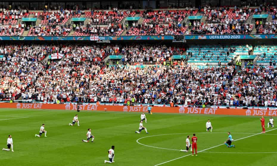 England's players take a knee, applauded by Denmark's,