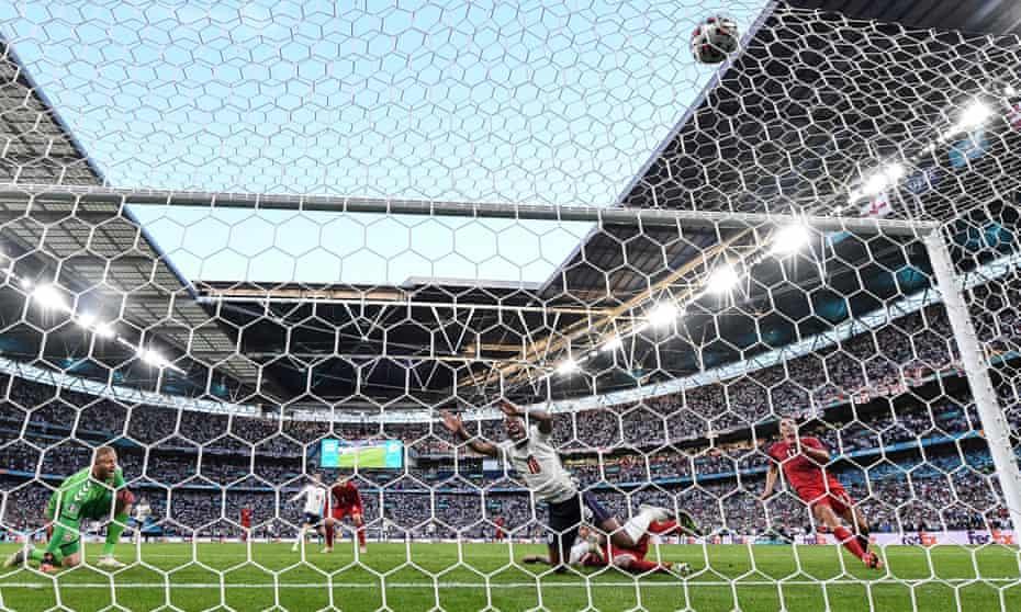Simon Kjær turns the ball into his own net under pressure from Raheem Sterling.