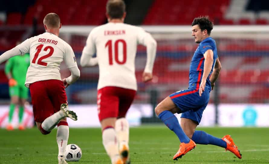 Harry Maguire lunges into the tackle on Denmark's Kasper Dolberg for which he was sent off in the Nations League at Wembley last year.