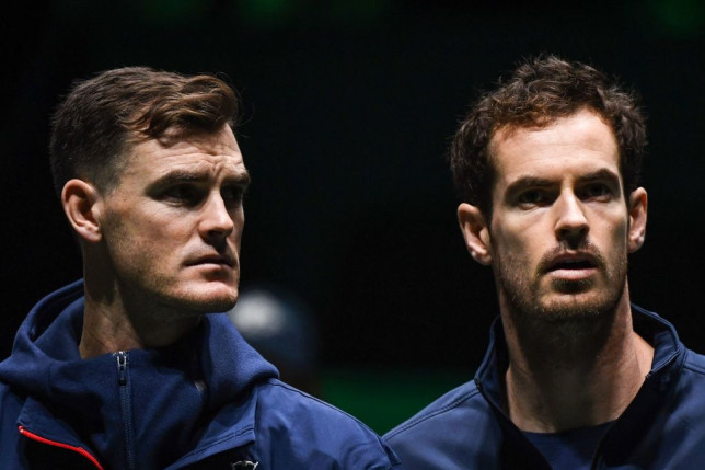 Great Britain's Andy Murray (R) and Great Britain's Jamie Murray (L) stand prior to the singles tennis match between Great Britain and Netherlands at the Davis Cup Madrid Finals 2019 in Madrid on November 20, 2019.