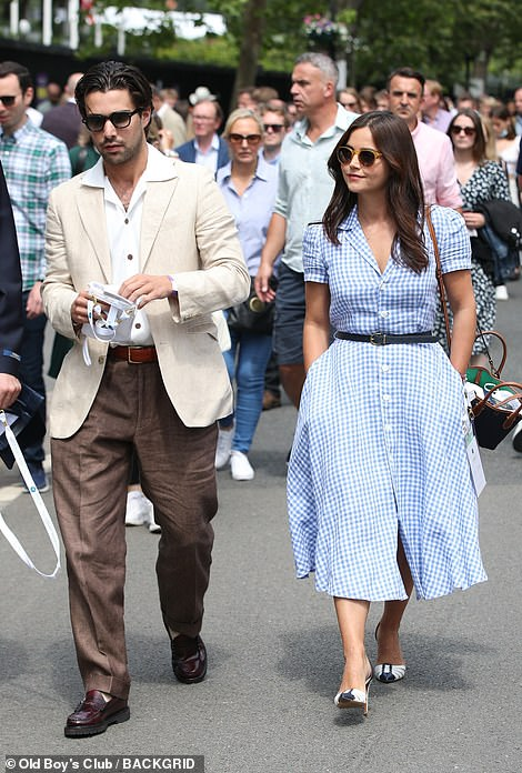 Stunning:Leading the glamorous crew was Jenna, 35, who looked sensational in a blue checked dress that flared out to calf length