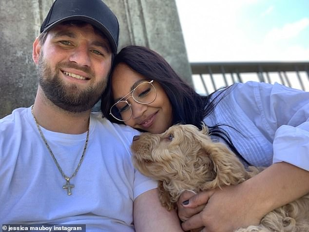 Long wait: Jessica Mauboy is keen to marry her fiancé Themeli Magripilis. However after a series of delays, the singer, 31, has resigned herself to waiting a little while longer to marry her partner of 14 years. Pictured with their pet pooch