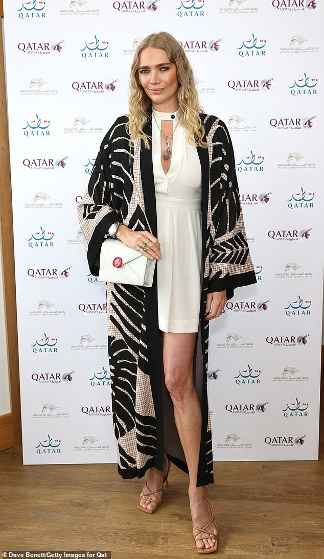 Model behaviour:Jodie Kidd put on a fashionable display in a white mini dress and a monochrome kimono while attending the Goodwood Festival on Saturday
