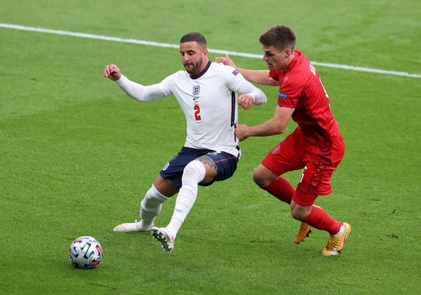 Kyle Walker of England battles for possession with Joakim Maehle