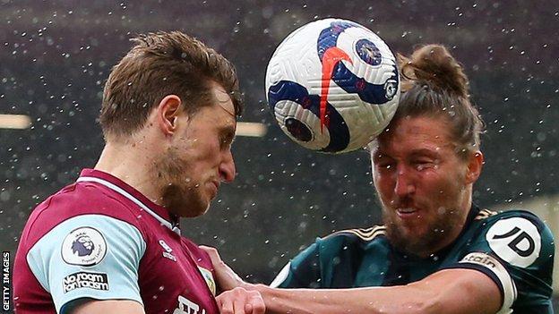Burnley's Chris Wood battles for a header with Luke Ayling of Leeds United