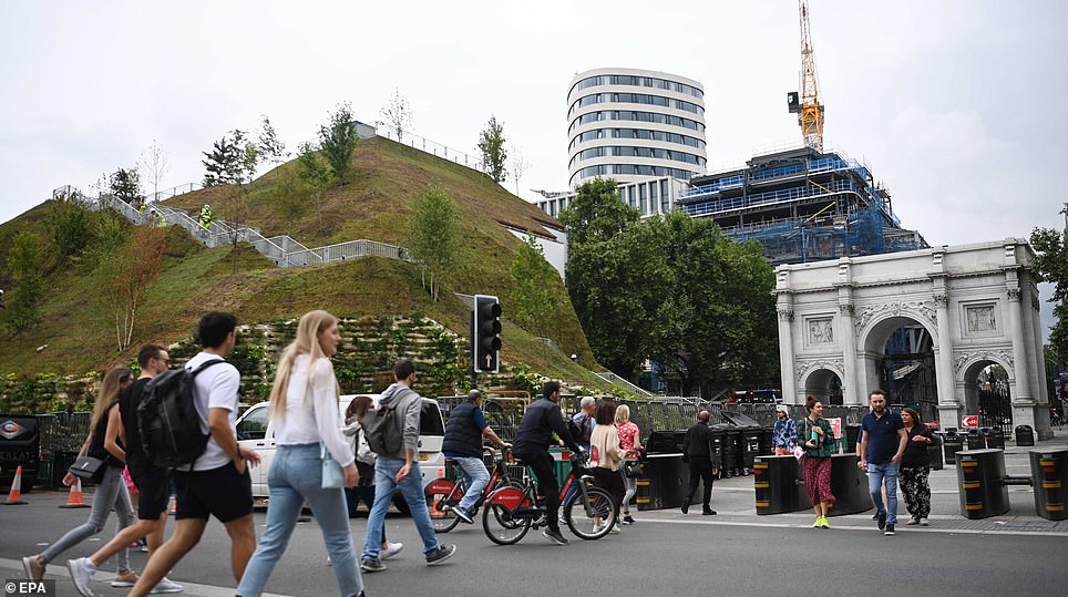 Construction workers finish work of the Marble Arch Mound in London just two days before it finally opened its doors