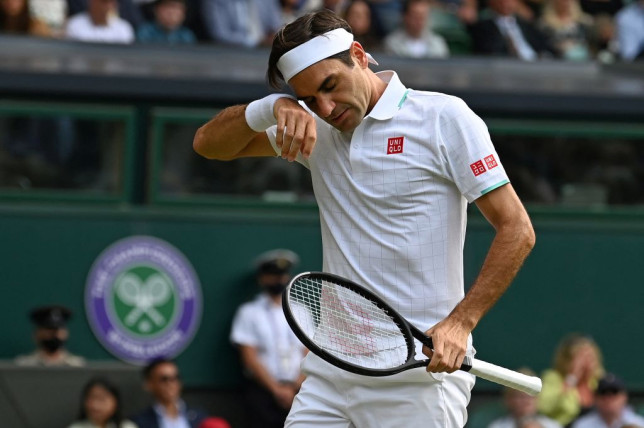 Switzerland's Roger Federer reacts against Poland's Hubert Hurkacz during their men's quarter-finals match on the ninth day of the 2021 Wimbledon Championships at The All England Tennis Club in Wimbledon, southwest London, on July 7, 2021.