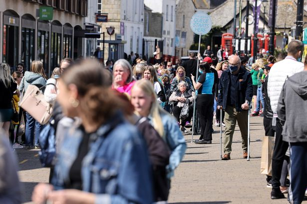 Crowds of people in a busy high street