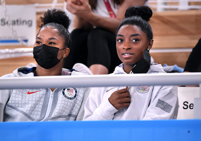 Simone Biles, right and teammate Jordan Chiles watched the women's individual all-around final from the sidelines