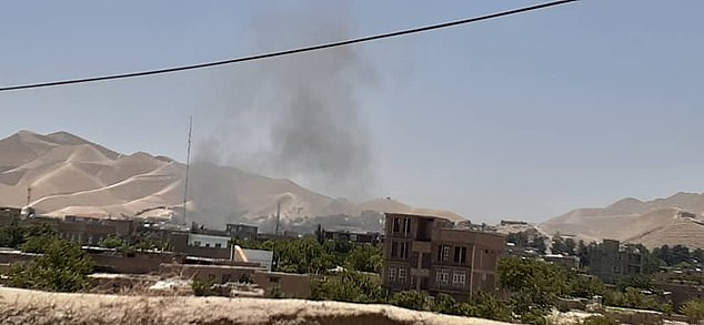 The Taliban on Wednesday launched their first assault on Qala-i-Naw, Afghanistan, since waging a major offensive against government force (pictured, smoke rising from the town on Wednesday)