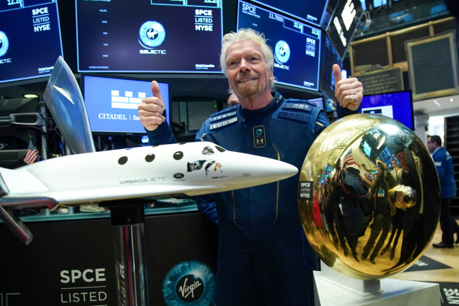 NEW YORK, NY - OCTOBER 28: ??Sir Richard Branson, Founder of Virgin Galactic, poses for photographs before ringing a ceremonial bell on the floor of the New York Stock Exchange (NYSE) to promote the first day of trading of Virgin Galactic Holdings shares on October 28, 2019 in New York City. Virgin Galactic Holdings became the first space-tourism company to go public as it began trading on Monday with a market value of about $1 billion. (Photo by Drew Angerer/Getty Images)